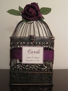wedding bird cage for cards - custom ordered with purple ribbon and no flower - added my own flowers that matched reception tables