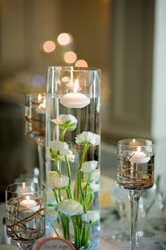 I found this great wedding vendor on The Knot! Non Floral Centerpieces, White Centerpiece, Wedding Centerpieces, Floral Arrangements, Centrepiece Ideas, Floating Candles Wedding, Floating Candle Centerpieces, Vases Decor, Reception Table Decorations