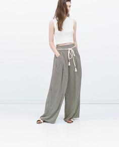 Immagine 1 di PANTALONI STAMPATI di Zara