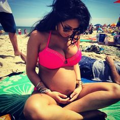 It seems like when woman get pregnant they go straight for a one piece bathing suit. I think having a little baby belly in a bikini is adorable though.