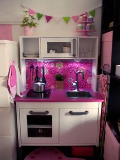 IKEA play kitchen. My little girl will have this someday :) haha I want it for myself !