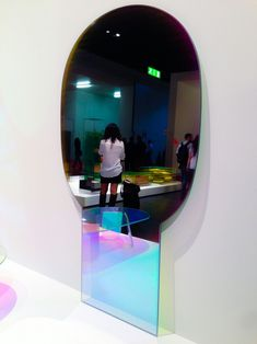 shimmer mirror by patricia urquiola for glas italia at milan furniture fair - and her outfit