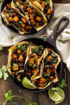 Butternut squash, black beans, and kale seasoned with warm Southwest spices are the perfect pairing in these vegetarian and gluten-free tacos!