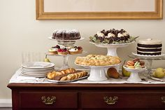 Using pedestals to add height to a dessert buffet; inspired by Martha Stewart. I need more pedestals.
