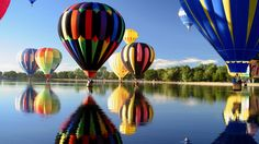https://hqwallbase.site/images/bigest/1600x900_colorful_river_hot_air_balloons-189156.jpg