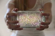 fairy dust in a jar.     open a glow stick & shake contents into a jar, add glitter seal top with lid. by faye