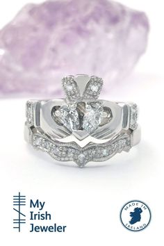 This spectacular Claddagh ring is set with two magnificent pear-shaped diamonds to create a heart shaped diamond. Pave set diamonds are embedded in the crown of the ring and complimented by diamonds in the cuffs of the hand. To complete the look there is a matching 3mm diamond encrusted wedding band. Irish Wedding Rings, Irish Rings, Celtic Rings, Claddagh Engagement Ring, Engagement Wedding Ring Sets, Wedding Bands, Heart Shaped Diamond, Brilliant Diamond, Pear Shaped