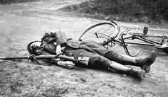 Fallen Belgian dispatch rider, WWI  He was probably composed for the pic, with his rifle and his bike near him