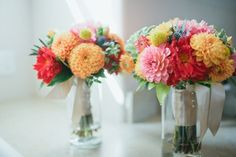 cheerful dahlia, craspedia, and blue globe thistle (photo by abiqphotography.com, flowers by katebakerflorals.com)