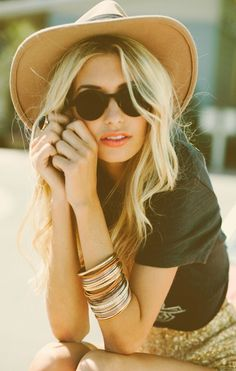 Love stacked bracelets and summer hat.