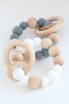 Baby teething toy with wooden rings / Food grade silicone beads / Organic beech wooden beads Newborn Toys, Baby Toys, Sensory Tools, Baby Massage, Baby Teethers, Wooden Rings, Mild Soap, Wooden Beads, Bebe