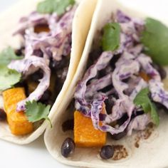 This easy recipe for roasted sweet potato tacos are topped with black beans and a spicy chipotle slaw.