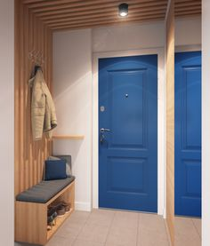 Colorful and space savvy entry of Igralnaya designed by Geometrium Tiny Apartment Blends Space Savvy Design with Scandinavian Style Foyer Design, Hall Design, House Design, Entry Hallway, House Entrance, Painted Doors, Apartment Design, Small Apartments, Scandinavian Style