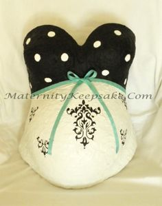 Cute black and white polka dot with a damask print.  By Maternity Keepsake.