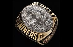 The Super Bowl XXIX San Francisco Forty Niners ring (by Balfour) features 5 large Marquis cut diamonds and 5 tapered baguettes along with pave diamonds. Ohhh how beautiful.not necessarily the ring but the trophies! Nfl Championship Rings, Nfl Championships, Sf Niners, Forty Niners, Nfl 49ers, 49ers Fans, Nfl Fans, Football Rings, Nfl Football