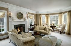 formal-living-room-with-beige-furniture-fireplace-and-bay-window