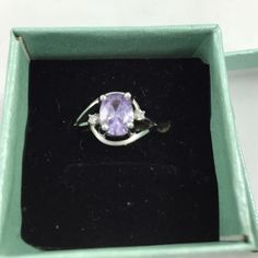 Beautiful Amethyst ring Size 6 silver with amethyst purple and clear side stones. No marks Jewelry Rings