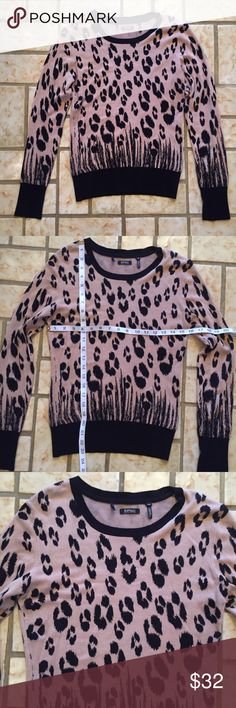 Buffalo David Bitton Soft Leopard Sweater This sweater is so soft and cute! It is from Buffalo David Bitton and is a size medium. It is brown and black in person and is in excellent used condition.   Please let me know if you have any questions. Measurements can be seen in the pictures. Bundle with my other items for a good deal. Thanks for looking! Buffalo David Bitton Sweaters Crew & Scoop Necks