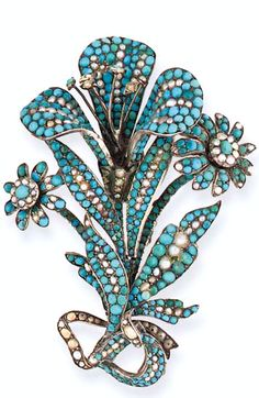 A 19th century turquoise and half-pearl brooch  Of floral spray design, the central flowerhead with trefoil petals set amongst leaves and two flowerheads, to a ribbon bow tie, pavé set throughout with turquoise and accented with half-pearls, in silver mount, later brooch fitting