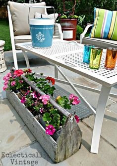 Vintage toolbox planter.  Easily replicated with new build, aged with vinegar/AAAA steel wool.