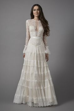 Vintage style lace wedding dress by Catherine Deane.