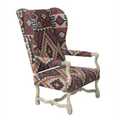 A high-back wing chair upholstered with a wool kilim would be so cool in a living room. Or how about one at either end of a large, rustic dining table?