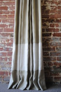 Two-toned banded linen curtains from Martha & Ash. These look great against the brick wall.