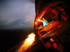 Larry Burrows photo of a crew of U.S. AC-47 plane, firing 7.62 mm GE mini-guns during a night mission over Vietnam