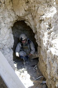 BALAD RUZ, Iraq (March 22, 2009) Petty Officer 2nd Class Jared Naegele, assigned to Explosive Ordnance Disposal Mobile Unit 1, prepares an explosive charge to destroy an enemy bunker found next to a canal south of Balad Ruz, Iraq. (U.S. Navy photo by Mass Communication Specialist 2nd Class Walter J. Pels/Released)