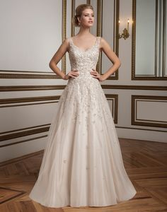 Justin Alexander wedding dresses style 8813 A timeless A- line gown with a V-neckline, embroidered beaded lace and full tulle skirt with scattered beaded details. The elegant gown is finished with a beaded motif illusion back.