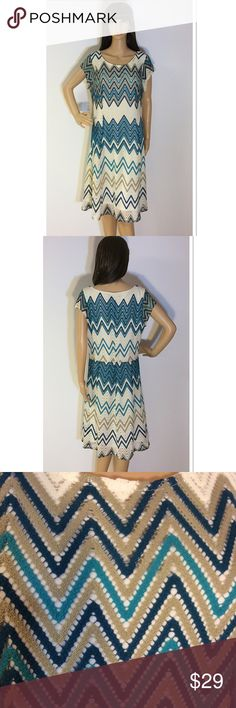 "SZ 12 SHARAGANO CHEVRON PRINT DRESS Beautiful dress with cap style sleeves and a pull on style. Gently used and fully lined. Measurements lying flat Armpit to armpit 19"" length waist 16.5"" length 41"" Sharagano Dresses Midi"