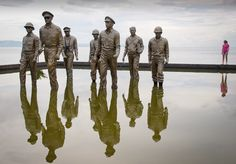 Leyte Landing Memorial in Red Beach, Palo, near Tacloban City, Leyte, the Philippines, where General MacArthur famously landed, so fulfilling is promise to return and liberate the Philippines from the Japanese in World War II.    I thought the perspective would be interesting with Elizabeth, my eldest daughter, stood to the right, viewing the memorial figures.