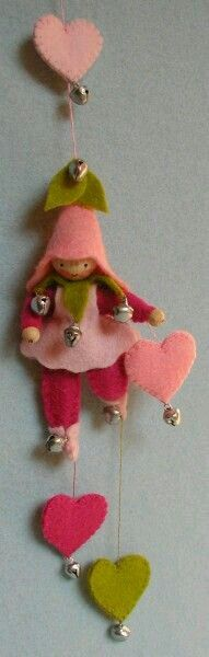 Spring peg doll with ginglebell hat