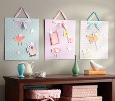 Printed Magnet Boards from Pottery Barn Kids. Cut squares of sheet metal and wrap in fabric prints.