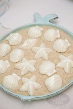 Beach themed birthday party - sugar (sand) and white chocolate (shells)