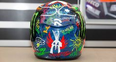 Jorge Lorenzo Barcelona Helmet 2013  The pattern for this special Lorenzo Barcelona helmet was put together by down syndrome sufferer Anna Vives, a well-known personality in Catalunya who has invented her own font.