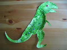 I saw this cute Brontosaurus on Kids Craft Weekly .  We used a couple of small paper plates and instead of brushes I had Lu...