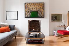 The print above the fireplace is by Canadian photographer Edward Burtynsky.