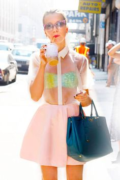 Natalie. [The sheer shirt paired with a bright top, full skirt, and blue handbag = #Fabulous!]