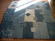 Denim picnic blanket quilt.  Uses old jeans to create a unique and functional blanket.