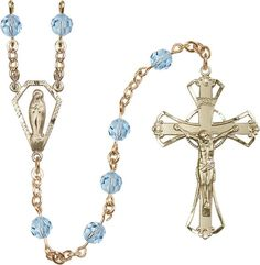 14kt Gold Filled Rosary features 6mm Alexandrite Swarovski beads. The Crucifix measures 1 3/4 x 1 1/8. The centerpiece features a Miraculous medal. Each Rosary