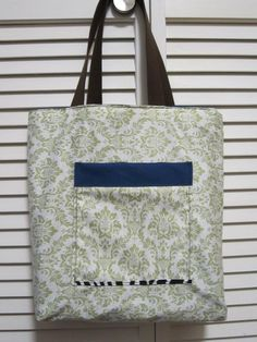 The Reversible Tote!  A Mint Green Paisley Print paired with the Navy Blue canvas! With the reversible tote you can wear it sophisticated or satisfy your fun side! Check it out on www.etsy.com/...