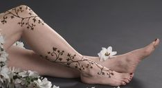 Vine tattoos look very elegant on legs, due to the perfect blend of the tattoo design and its placement. The article provides a summary on vine tattoo meanings and designs. Flower Vine Tattoos, Pretty Flower Tattoos, Flower Tattoo Back, Ivy Tattoo, Tattoo On, Upper Arm Tattoos, Foot Tattoos For Women, Henna Tattoo Designs, Flower Tattoo Designs