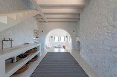 Greg Haji Joannides referred to historic photographs when creating a contemporary interior for this earthquake-damaged house on the Greek island of Nisyros Arched Windows, Windows And Doors, Tolle Hotels, Island Villa, Arch Doorway, Deco Nature, Greek House, Two Storey House, Lofts