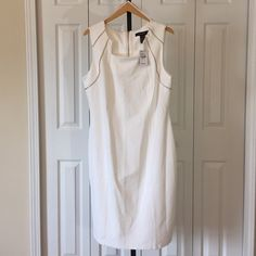 Sleeveless Dress NWT- never adorned, Women size 14/16 sleeveless, white 96% polyester and 4% spandex (Stretch) dress. Front gold tone zipper design pattern and back exposed gold tone metal exposed zipper style. Machine wash cold and tumble dry low. Ashley Stewart Dresses Midi