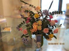 Sandra Wall Rubin, IGMA fellow - floral arrangement, made of hand cut, hand dyed paper; sold on ebay for $146