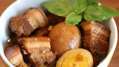 This recipe for Thit Kho, sticky-sweet caramelized pork belly with hard-boiled eggs, is popular in Vietnamese households served over rice.