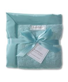 Tuck little ones in for a cozy ride with this cuddly soft blanket. Totally coo-worthy and created with cozy, sumptuous fabric, it's a blanket they'll love taking with them on every adventure. The soft, satiny trim lends a cool finish, while the perfect blend of timeless and contemporary design means this blankie will never go out of style.