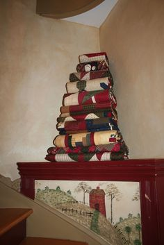 Stacked red quilts from Sandy Gervais