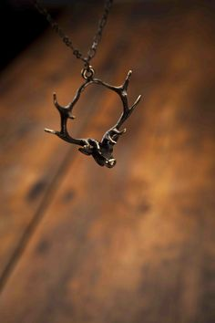 Bronze Hanging Deer Necklace from Angel Court and Bourbon & Boots